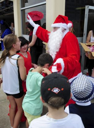 The Queanbeyan Cup horse race meeting. Santa pays a visit.