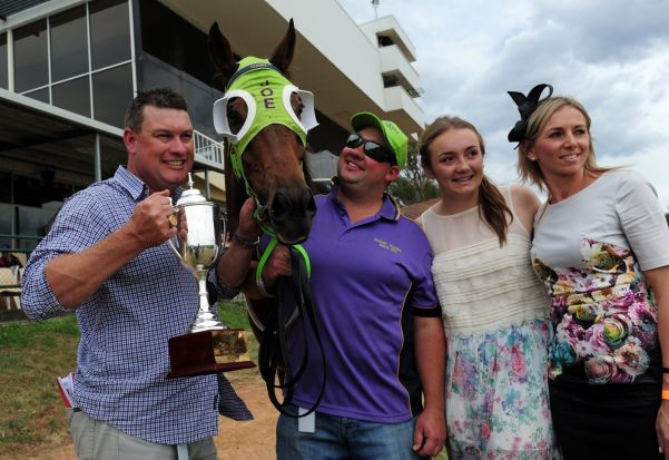 Landlocked, ridden by John Kissick, won the cup. From left, trainer Joe Cleary holding the cup, strapper Dane Cleary ...