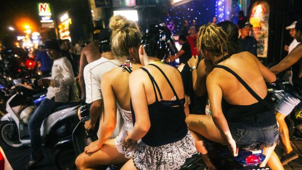 Australian schoolies live it up in Bali's party street, Jalan Legian. Other schoolies, not pictured, say they are still ...
