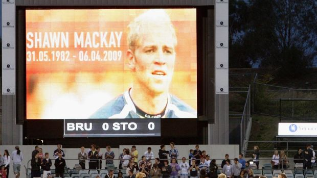 Brumbies players gather to applaud former team mate Shawn Mackay who recently passed away, before the round nine Super ...