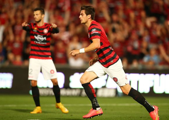 Tomi Juric of the Wanderers celebrates his goal.