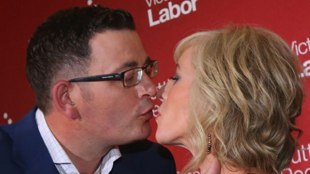 Incoming Victorian Premier Daniel Andrews kisses his ''secret campaign weapon'', wife Cath after his victory speech.