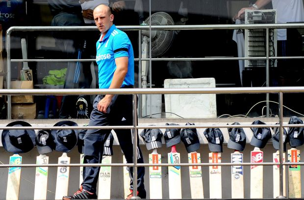 England cricketer James Tredwell walks past England bats and caps lined up in tribute during the second One Day ...