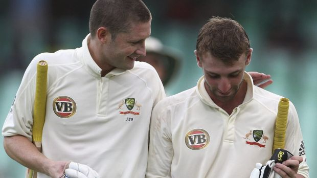 Michael Clarke and Phillip Hughes leave the pitch during Australia's tour of South Africa in 2009.