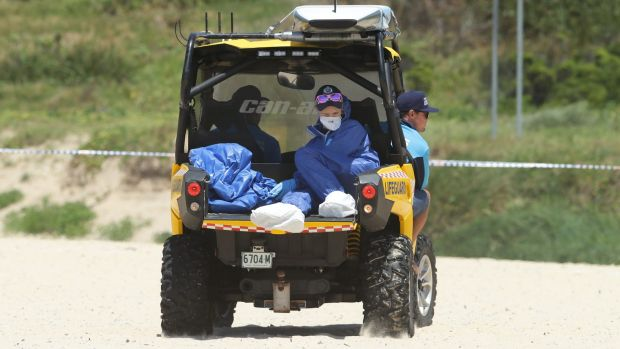 Police Forensic Services transport the remains of the infant off the beach on Sunday.