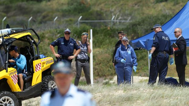 Crime scene: Police, lifeguards and a forensic team at Maroubra Beach.