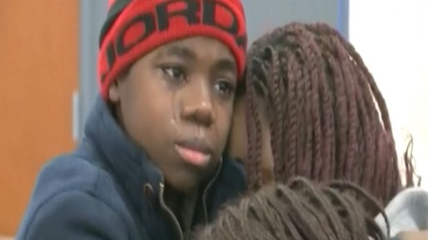 Tearful reunion: The rescued boy is reunited with his mother.