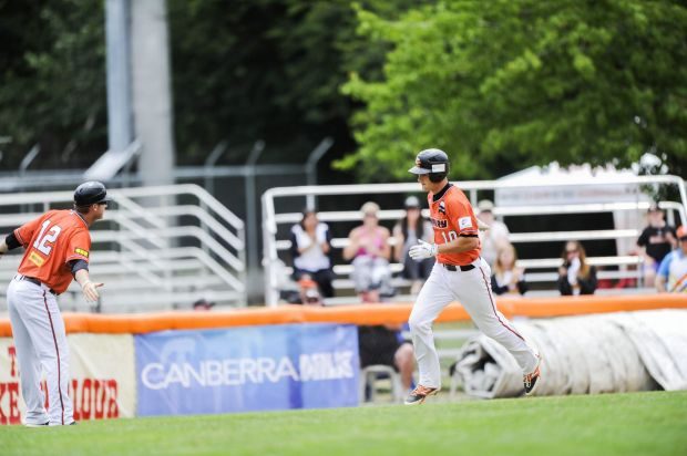 Canberra Cavalry's Mitch Walding runs home after hitting a home run with loaded bases.