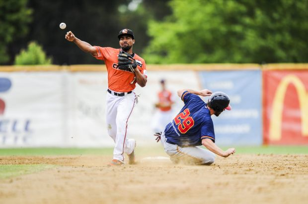 Adelaide Bite's Aaron Miller dives for base, but is run out by Cavalry's Marcus Lemon.