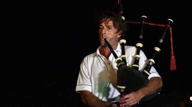 A lone piper performs during a remembrance ceremony for the late Australian batsman Phillip Hughes in Macksville,