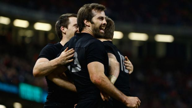 'Cuddlegate': Conrad Smith and Beauden Barrett share a celebratory hug during the All Blacks v Wales game ... little did ...
