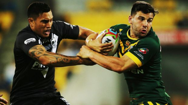 Roos still top: Josh Mansour of Australia tries to get past New Zealand's Dean Whare during the Four Nations final in ...