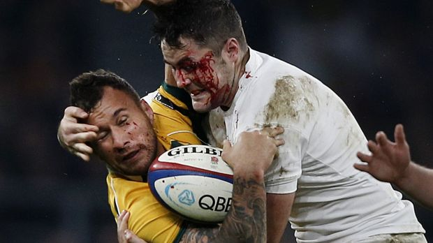 Rugged tour: Quade Cooper is smashed in a tackle by Brad Barritt.