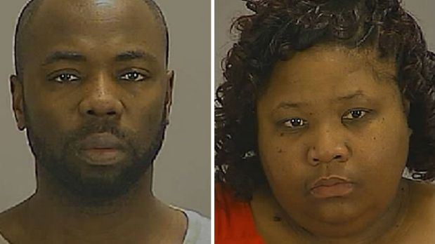 Charged: Gregory Jean and Samantha Joy Davis in booking photos provided by the Clayton County Sheriff's Department.