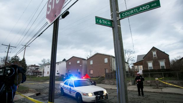 Columbus Police block the intersection near 6th Avenue and Cortland Avenue in Columbus, Ohio where the body of missing ...