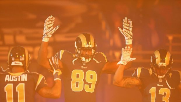 Tavon Austin, Jared Cook, Chris Givens of the St Louis Rams pay homage to Mike Brown by holding their hands up during ...