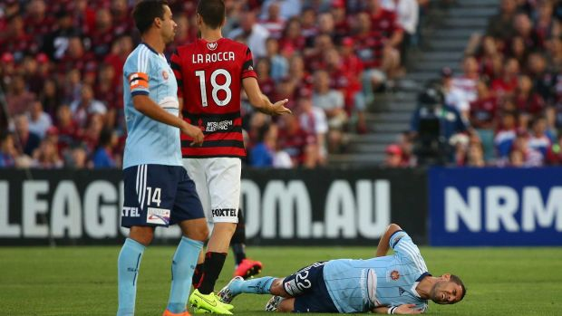 Ouch: Sydney FC star Ali Abbas lies on the Pirtek Stadium turf after suffering a season-ending injury in the tackle of ...