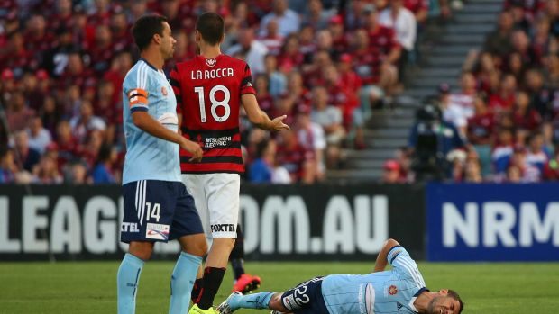 Down and out: Abbas in agony after the season-ending injury in the tackle of Western Sydney Wanderers' Iacopo la Rocca ...