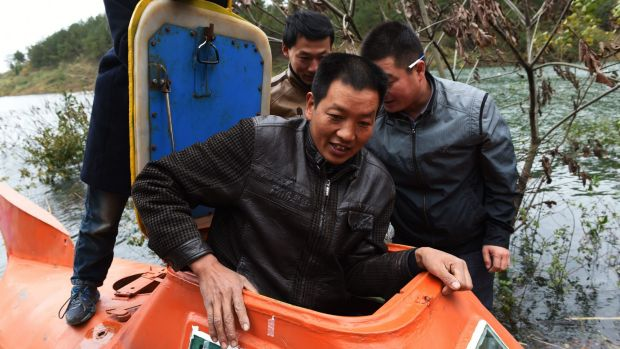 Farmer Tan Yong prepares to take his home-made submarine for a spin in Danjiangkou reservoir, in China's central Hubei ...