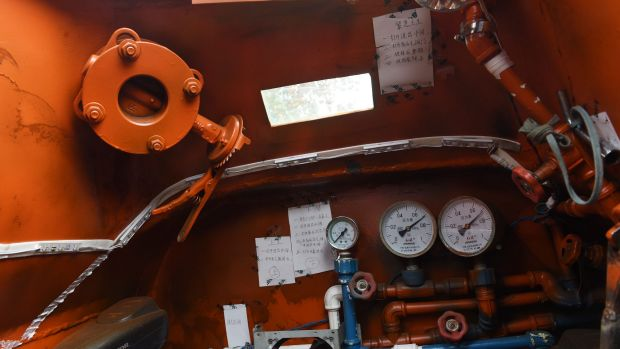 Pride of the chicken farmer: A look inside the home-made orange submarine.