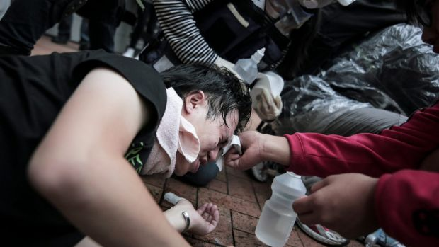 Medical aid: Riot police, armed with pepper spray, batons and water hoses, moved in to disperse the demonstrators.