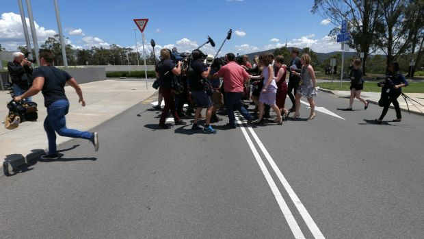 Media attempt to ask question of Senator Ricky Muir on Tuesday.