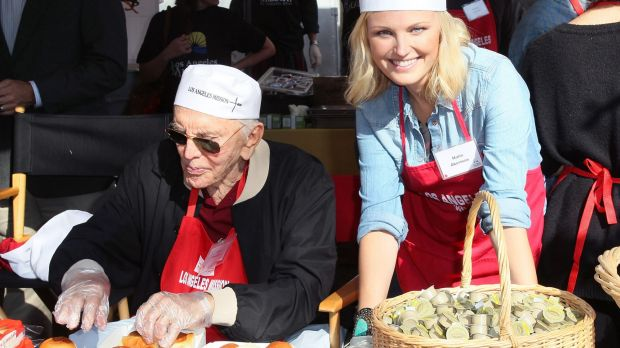Helping others: Kirk Douglas and Malin Akerman serve Thanksgiving lunch to the homeless in 2012.