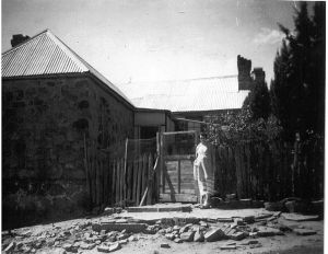 Mrs O'Brien outside Blundells Cottage in 1956. Mrs O'Brien boarded there with her husband.
