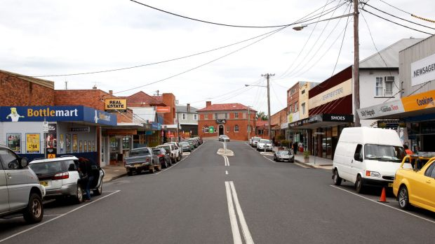 A stiller town: The main street in Macksville was quiet on Tuesday, but will be packed today, with thousands of mourners ...
