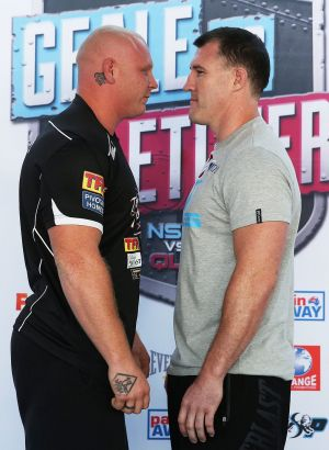 Face-to-face: Anthony Watts (left) and Paul Gallen get up close and personal at Tuesday's weigh-in.
