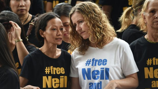 Tracy Bantleman (right), wife of accused Canadian teacher Neil Bantleman, listens to Siska Tjiong, wife of co-accused ...