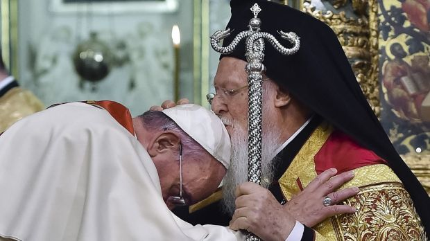 Ecumenical Patriarch Bartholomew I, right, kisses Pope Francis' head during an ecumenical prayer at the Patriarchal ...