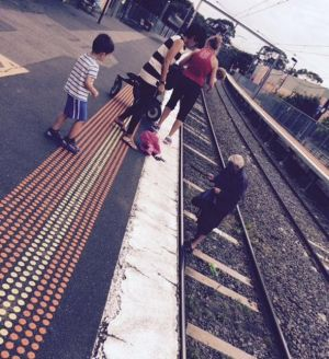 The toddler fell onto the tracks at Diamond Creek train station shortly before 11.30am.