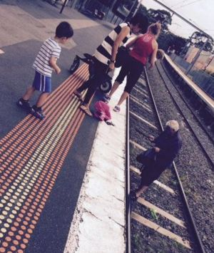 The toddler fell onto the tracks at Diamond Creek train station about 11am.