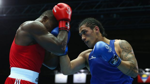 Turning professional: Australian boxer Jai Opetaia (blue) competes at the Commonwealth Games in Glasgow in July.