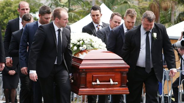 Final farewell: Brother Jason, left, and father Greg, right, carry Phillip Hughes' coffin during the funeral service.