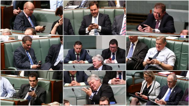 Coalition MPs seem distracted during a division for Education Minister Christopher Pyne's higher education bill.