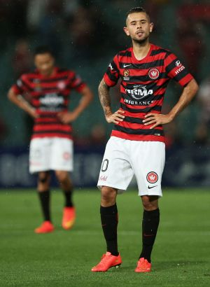 Vitor Saba and his Wanderers teammates show their frustration after the final whistle against the Roar.