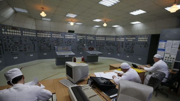 Accident reported on Friday ... Workers are pictured inside the central control room at the Zaporizhzhya nuclear power ...