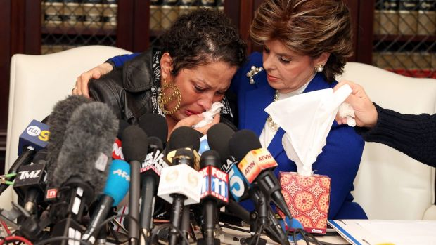 Bad experience: High-profile attorney Gloria Allred comforts one of the alleged victims of Bill Cosby at a press ...