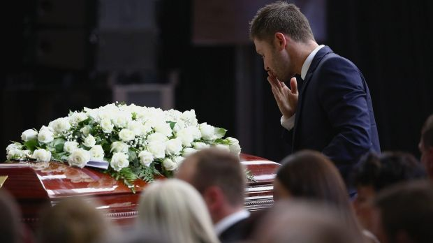 Funeral: Michael Clarke pays his respects.