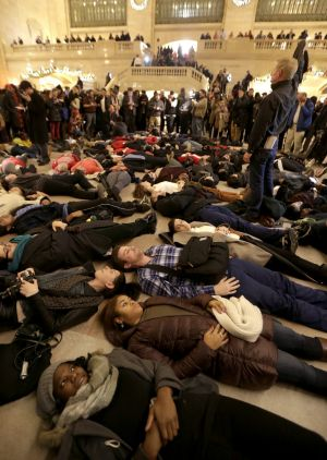 """Protesters stage a """"die-in"""" at New York's Grand Central Station after the decision was announced."""