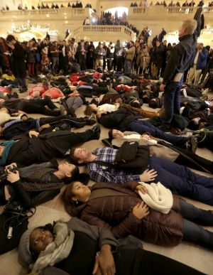 """Protesters stage a """"die-in"""" at New York's Grand Central Station after the Garner decision was announced."""