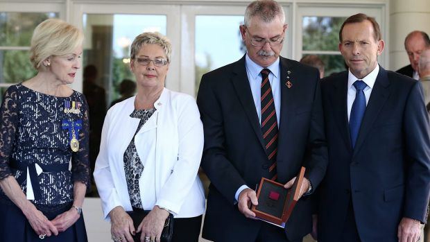 Doug and Kaye Baird are presented with a Victoria Cross for their late son Corporal Cameron Baird VC MG by ...