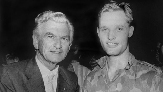 Michael Le Serve as an 18-year-old army private in 1989 with then-prime minister Bob Hawke.