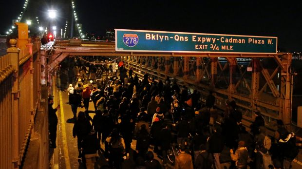 A group of protesters rallying against a grand jury's decision not to indict the police officer involved in the death of ...