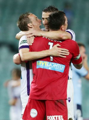 Jubilation: Perth Glory players celebrate their come-from-behind win.