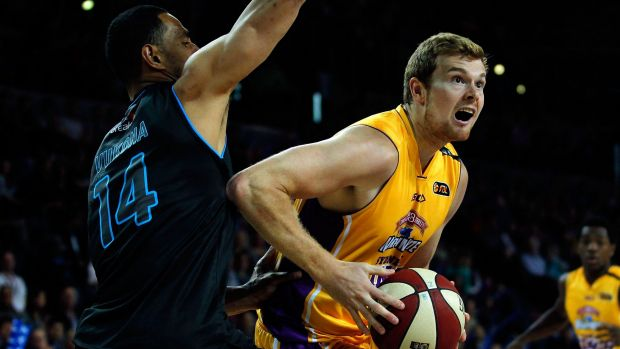 Improved performer: Kings co-captain Tom Garlepp drives to the basket in the recent clash with the Breakers.