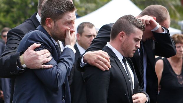 United in grief: Michael Clarke is comforted as he arrives at Phillip Hughes' funeral on Wednesday.