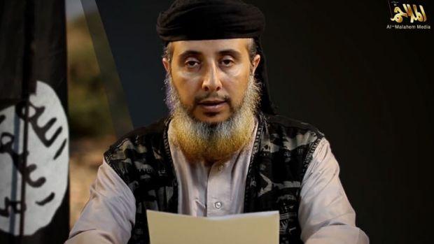 Nasser bin Ali Al-Ansi, of al-Qaeda in the Arabian Peninsula, reads a message threatening to kill US hostage Luke ...